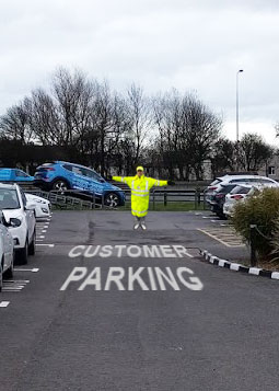 delership staff managing customer parking