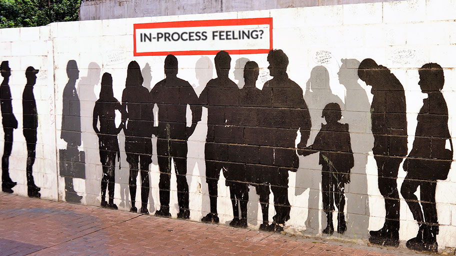 Graffiti style artwork showing people queuing