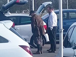 dealership forecourt browsing customer